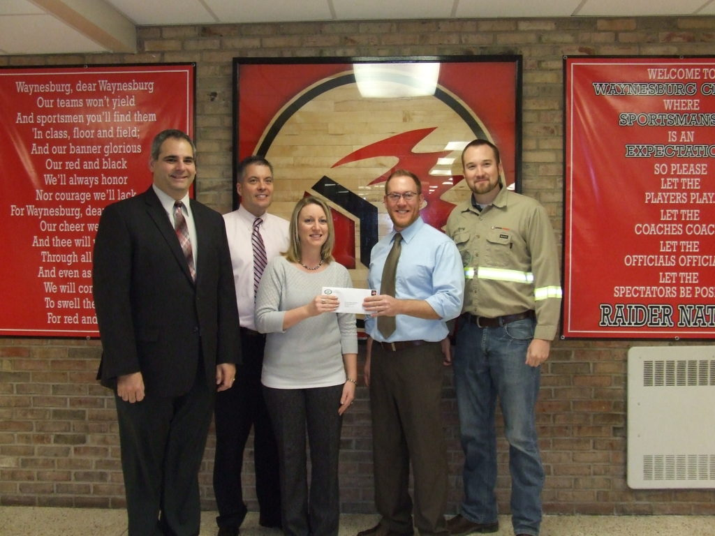 A Central Greene teacher receives a CONSOL Energy excellence in education fund grant.