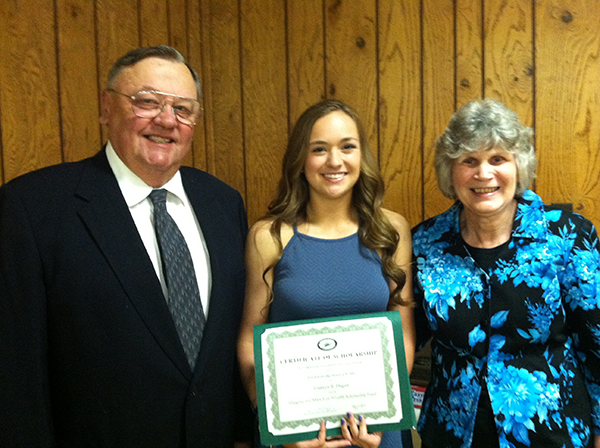 Greg and Mary Lou Niverth with a recipient of their scholarship award.