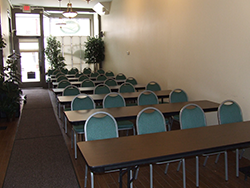 Foundation Room set up for a workshop with rows of tables and chairs